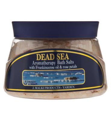 Black dress in dead sea bath