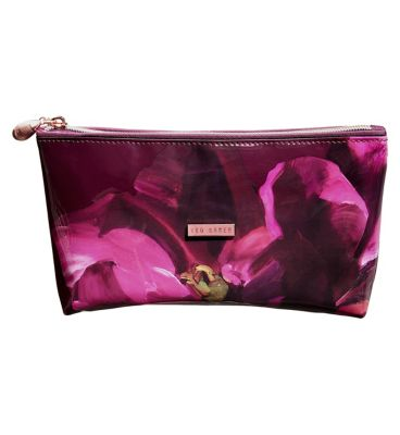 Wash & Make up Bags. From feminine floral prints to leather bow detailing, Ted's pretty and pattered make-up bags are ideal for keeping your lotions and potions in order.