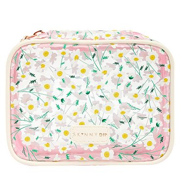 Skinny Dip Daisy travel set with bottles